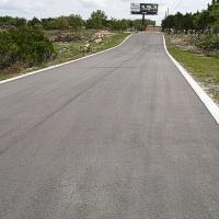 Smėlis ir asfaltas